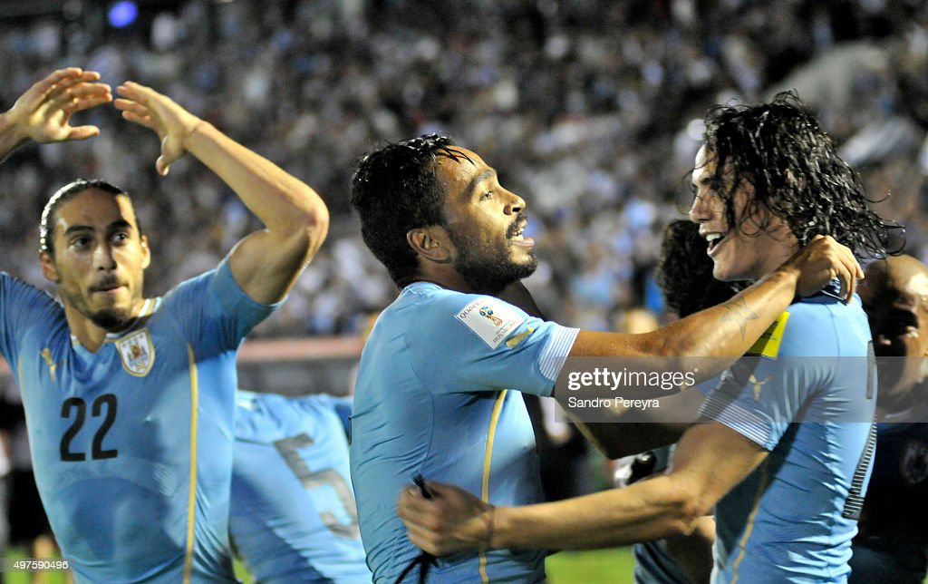Alvaro Pereira of Uruguay celebrates with Edinson Cavani after scoring the second goal of his team during a match between Uruguay and Chile as part of FIFA 2018 World Cup Qualifiers at Centenario Stadium on November 17, 2015 in Montevideo, Uruguay.