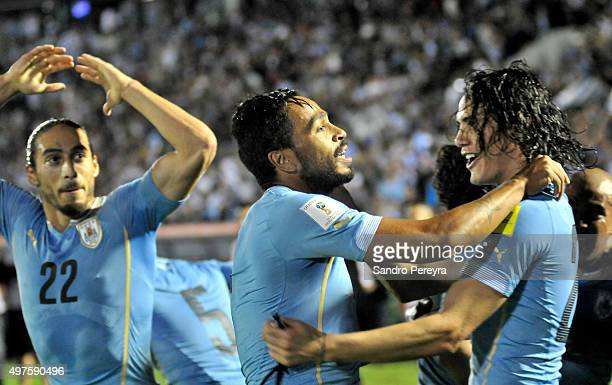 Alvaro Pereira of Uruguay celebrates with Edinson Cavani after scoring the second goal of his team during a match between Uruguay and Chile as part...