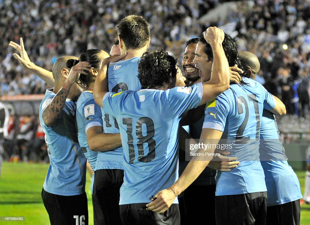 Alvaro Pereira of Uruguay celebrates with teammates after scoring the second goal of his team during a match between Uruguay and Chile as part of FIFA 2018 World Cup Qualifiers at Centenario Stadium on November 17, 2015 in Montevideo, Uruguay.