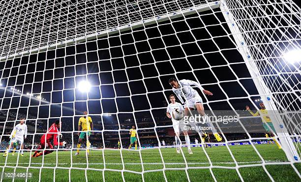 Alvaro Pereira of Uruguay heads in their third goal during the 2010 FIFA World Cup South Africa Group A match between South Africa and Uruguay at...