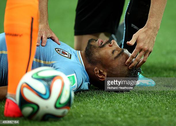 Alvaro Pereira of Uruguay receives treatment during the 2014 FIFA World Cup Brazil Group D match between Uruguay and England at Arena de Sao Paulo on...