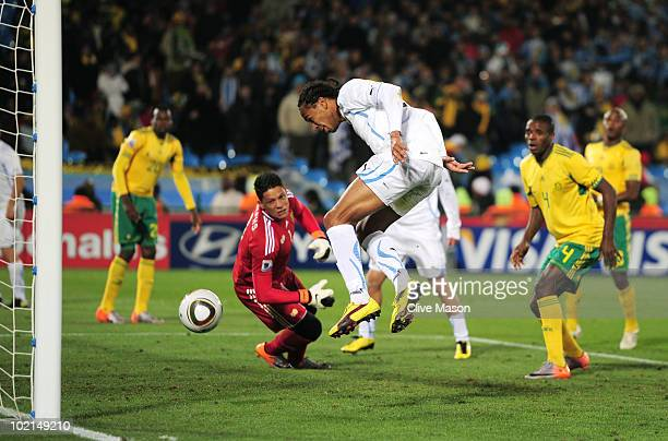 Alvaro Pereira of Uruguay scores the third goal during the 2010 FIFA World Cup South Africa Group A match between South Africa and Uruguay at Loftus...