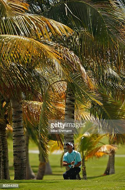 Alvaro Quiros hits out of the trees on the 8th hole during the third round of the Puerto Rico Open presented by Banco Popular held on March 22 2008...