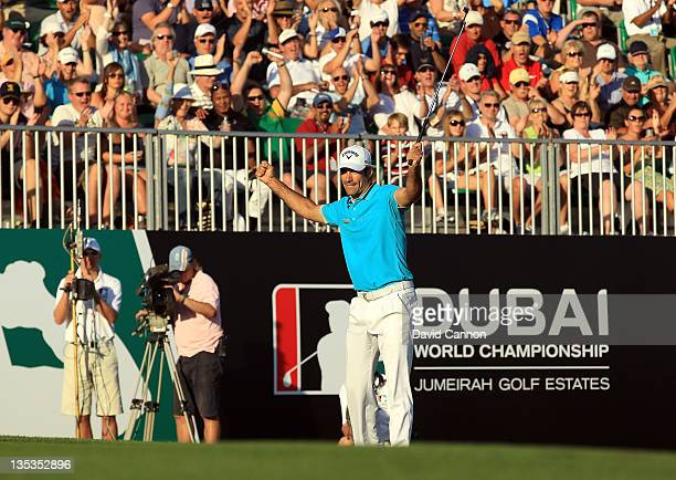 Alvaro Quiros of Spain celebrates holing an eagle putt at the par 5 18th hole on his way to an eight under par round of 64 and a four shot lead at...
