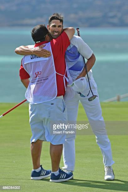 Alvaro Quiros of Spain embraces his caddie after victory during the final round on day four of The Rocco Forte Open at Verdura Golf and Spa Resort on...