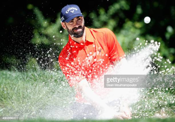 Alvaro Quiros of Spain hits a tee shot out of the bunker during the Open de Espana ProAm at PGA Catalunya Resort on May 14 2014 in Girona Spain