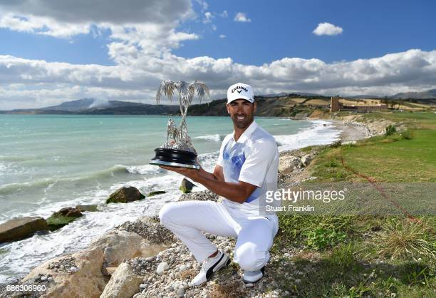 Alvaro Quiros of Spain holds the trophy after winning The Rocco Forte Open at The Verdura Golf and Spa Resort on May 21 2017 in Sciacca Italy