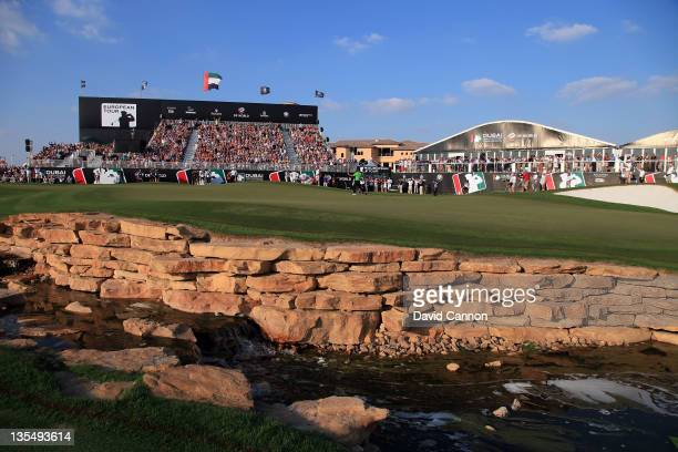 Alvaro Quiros of Spain holes an eagle putt at the par 5 18th hole to secure his win during the final round of the Dubai World Championship on the...