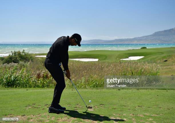 Alvaro Quiros of Spain plays a shot on the seventh hole during the third round of The Rocco Forte Open at The Verdura Golf and Spa Resort on May 20...