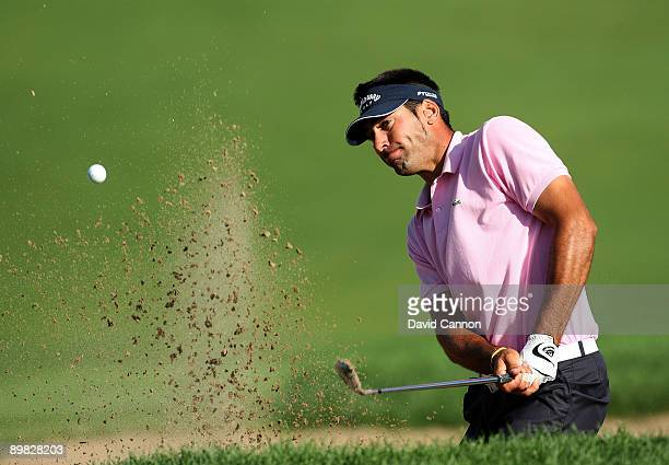 Alvaro Quiros of Spain plays from a bunker on the 18th hole during the final round of the 91st PGA Championship at Hazeltine National Golf Club on...