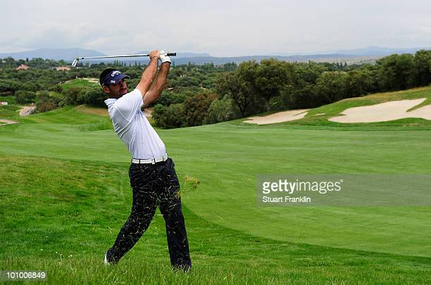Alvaro Quiros of Spain plays his approach shot on the nineth hole during the first round of the Madrid Masters at Real Sociedad Hipica Espanola Club...