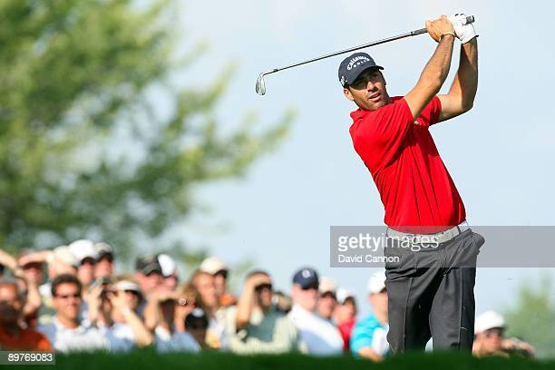 Alvaro Quiros of Spain plays his approach shot on the tenth hole during the first round of the 91st PGA Championship at Hazeltine National Golf Club...