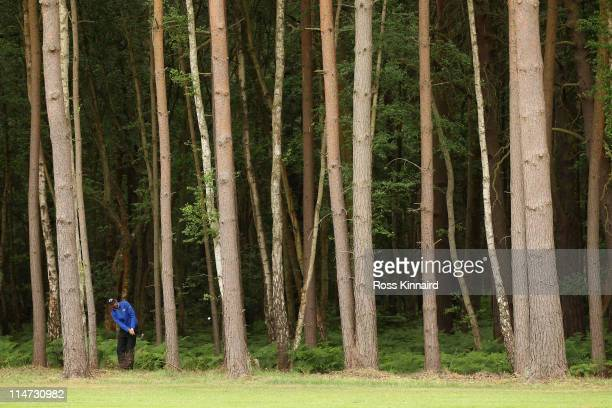 Alvaro Quiros of Spain plays his shot from the trees during the first round of the BMW PGA Championship at Wentworth Club on May 26 2011 in Virginia...