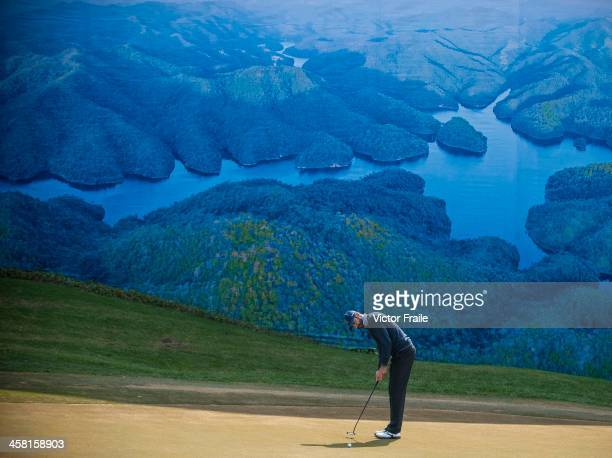 Alvaro Quiros of Spain putts on at the 6th green during the Royal Trophy Europe vs Asia Championship at the Dragon Lake Golf Club on December 20 2013...