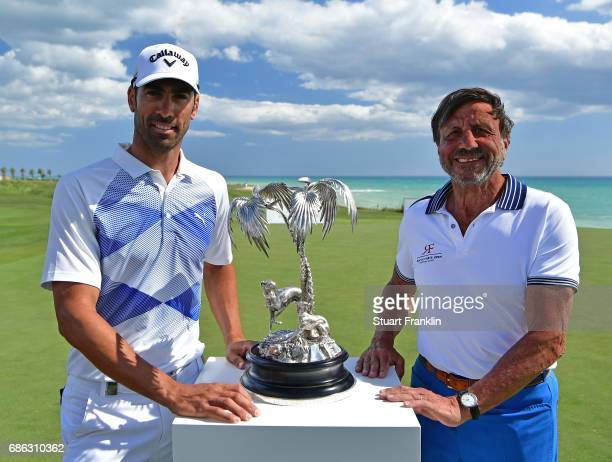 Alvaro Quiros of Spain recieves the trophy from Sir Rocco Forte after winning The Rocco Forte Open at The Verdura Golf and Spa Resort on May 21 2017...