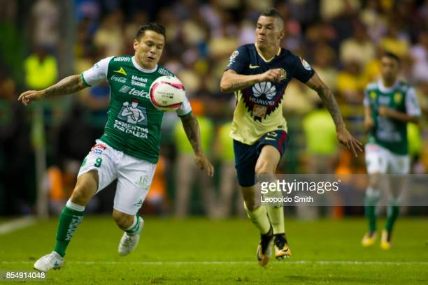 Alvaro Ramos of Leon fights for the ball with Andres Uribe of America during the 11th round match between Leon and America as part of the Torneo...