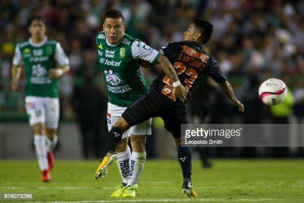 Alvaro Ramos of Leon figths for the ball with José Vazquez of Chivas during the 17th round match between Leon and Chivas as part of the Torneo...