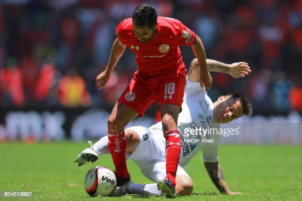 Alvaro Ramos of Leon struggles for the ball with Rodrigo Lopez of Toluca during the 2nd round match between Toluca and Leon as part of the Torneo...
