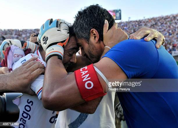 Alvaro Recoba and Gustavo Munua of Nacional celebrate after winning a match between Nacional and Peñarol as part of round 12th of Campeonato Apertura...