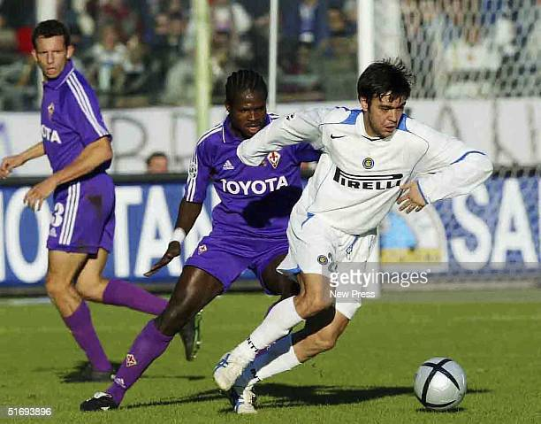 Alvaro Recoba of Inter Milan goes past Christian Obodo of Fiorentina during the Serie A match played at the Artemio Franchi stadium November 7 2004...