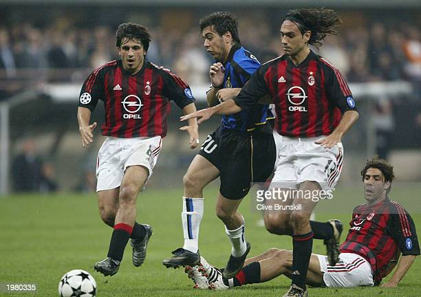 Alvaro Recoba of Inter Milan is tackled by Alessandro Nesta and Gennaro Gattuso of AC Milan during the Champions League SemiFinal First Leg match...