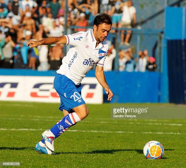 Alvaro Recoba of Nacional drives the ball during a match between Cerro and Nacional as part of round 13 of Campeonato Apertura 2014 at Gran Parque...