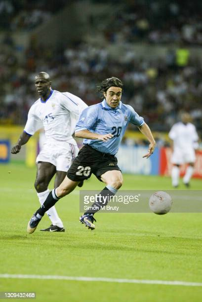 Alvaro Recoba of Uruguay and Lilian Thuram of France in action during the World Cup 1st round match between France and Uruguay at the Busan Asiad...