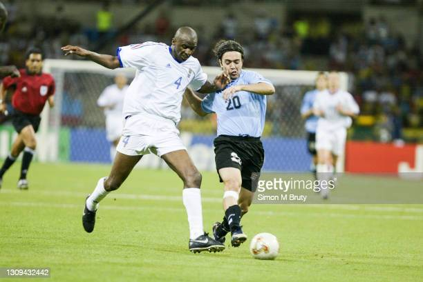 Alvaro Recoba of Uruguay and Patrick Vieira of France in action during the World Cup 1st round match between France and Uruguay at the Busan Asiad...