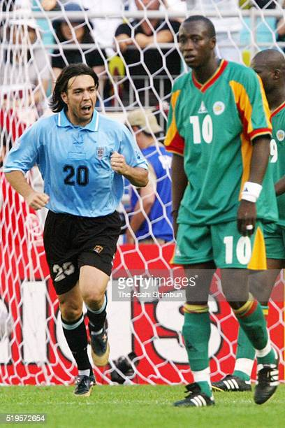 Alvaro Recoba of Uruguay celebrates scoring his team's third goal during the FIFA World Cup Korea/Japan Group A match between Senegal and Uruguay at...