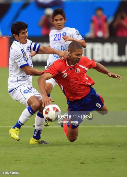 Alvaro Saborio of Costa Rica battles for the ball with Juan Jose Gomez of El Salvador during their game in the CONCACAF Gold Cup at Bank of America...