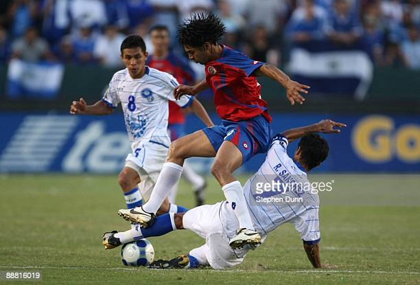 Alvaro Saborio of Costa Rica gets the ball stripped from his feet by Ramon Sanchez of El Salvador during the 2009 CONCACAF Gold Cup at The Home Depot...