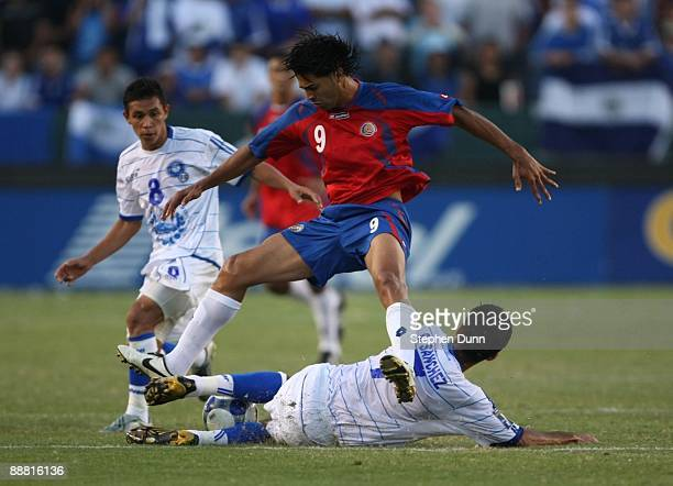 Alvaro Saborio of Costa Rica gets upended by Ramon Sanchez of El Salvador during the 2009 CONCACAF Gold Cup at The Home Depot Center on July 3 2009...