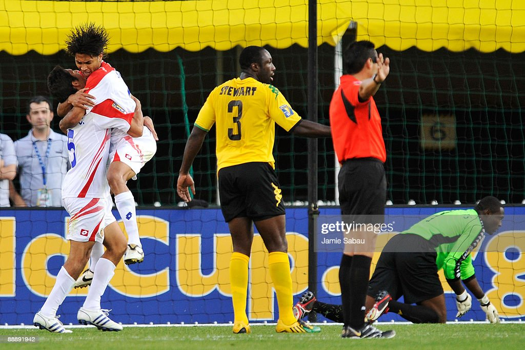 Alvaro Saborio #9 of Costa Rica jumps into the arms of Celso Borges #5 after Borges scored the only goal on goalkeeper Donovan Ricketts #1 of Jamaica at Crew Stadium on July 7, 2009 in Columbus, Ohio. Costa Rica defeated Jamaica 1-0.