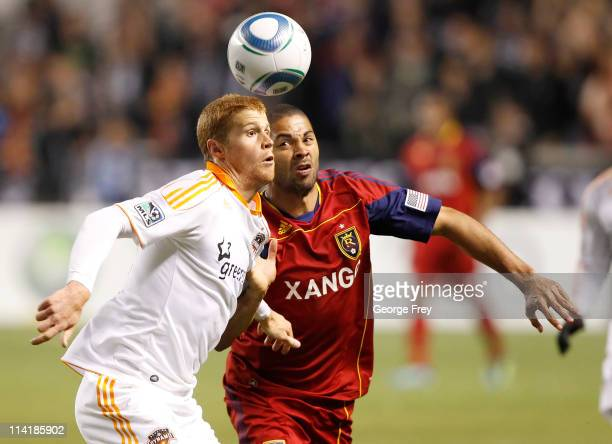 Alvaro Saborio of Real Salt Lake and Andrew Hainault the Houston Dynamo fight for the ball during the second half of an MLS soccer game May 14 2011...