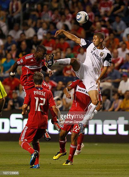Alvaro Saborio of Real Salt Lake leaps for a header over Kwame Watson-Siriboe, Logan Pause and Wilman Conde of the Chicago Fire in an MLS match on...