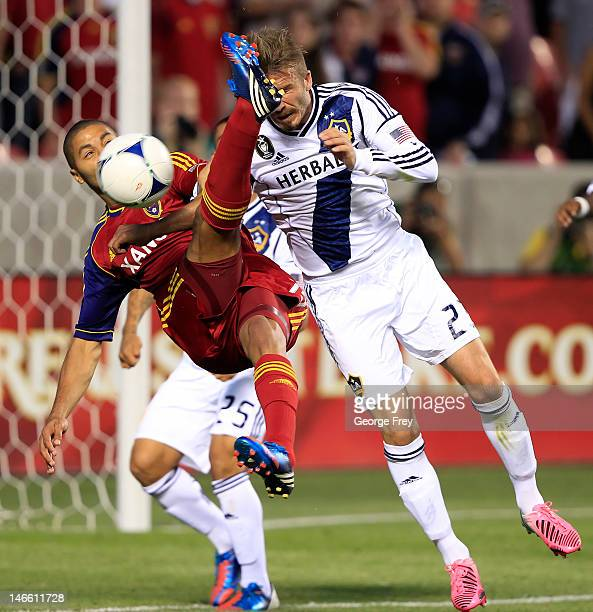Alvaro Saborio of Real Salt Lake takes a shot on goal past David Beckham of Los Angeles Galaxy during the second half of an MLS soccer game June 20...