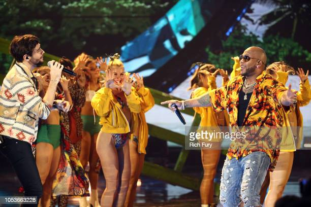 Alvaro Soler and Flo Rida perform onstage during the 2018 Latin American Music Awards at Dolby Theatre on October 25 2018 in Hollywood California