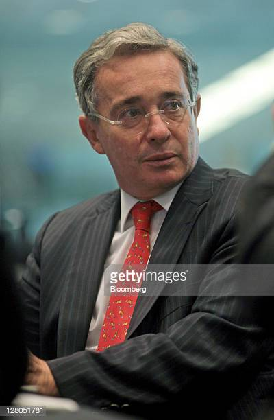 Alvaro Uribe former president of Colombia listens during an interview in New York US on Wednesday Oct 5 2011 Uribe who served as president of...