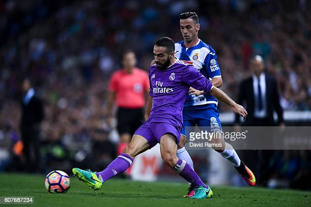 Alvaro Vazquez of RCD Espanyol competes for the ball with Daniel Carvajal of Real Madrid CF during the La Liga match between RCD Espanyol and Real...