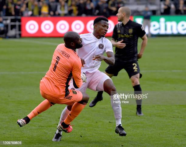 Alvas Powell of Inter Miami CF collides with Kenneth Vermeer of Los Angeles FC during a 10 Los Angeles FC win at Banc of California Stadium on March...
