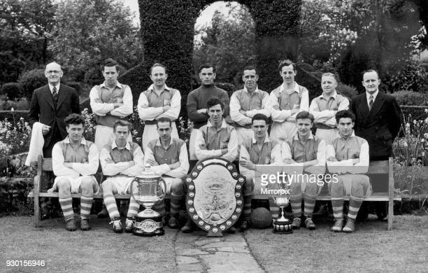 Alvechurch football club team group with trophies after winning the Redditch and District League championship the AE Terry Memorial Cup as well as...