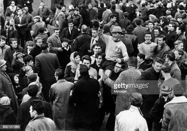 Alvechurch players mobbed by jubilant supporters following their victory against Wealdstone in the FA Amateur Cup tie 13th February 1965