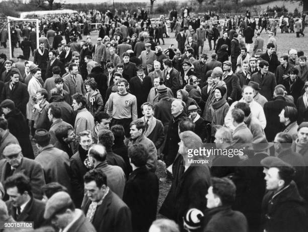 Alvechurch players mobbed by jubilant supporters following their victory against Wealdstone in the FA Amateur Cup tie Pictured is Mason in the midst...