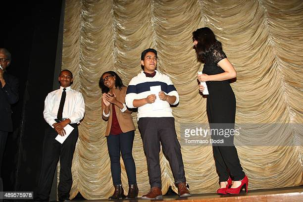 Alvie Johnson honors filmmakers Isaiah Ray Pearce Leslie Torres and Guillermo Mora with a scholarship during the Film Independent at LACMA screening...