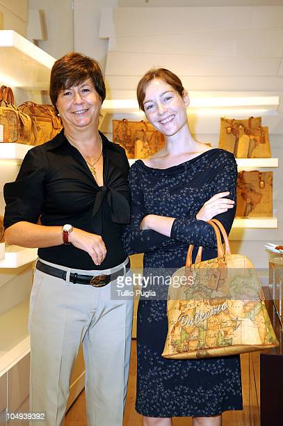 Alviero Martini CEO Antonella Memo and actress Cristiana Capotondi pose with the special edition bag 'Palermo' during the press preview of Alviero...