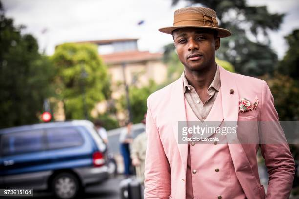 Alvin Alto wearing a brown hat and pink vest and blazer is seen during the 94th Pitti Immagine Uomo at Fortezza Da Basso on June 13 2018 in Florence...