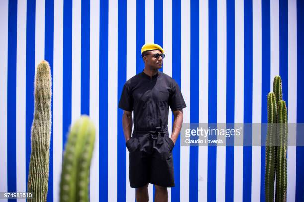 Alvin Alto wearing a yellow hat black shirt and black shorts is seen during the 94th Pitti Immagine Uomo at Fortezza Da Basso on June 14 2018 in...