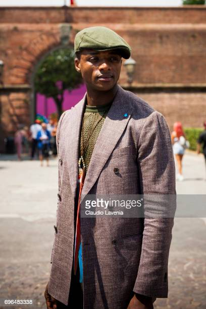 Alvin Alto wearing green shorts and flat cap is seen during Pitti Immagine Uomo 92 at Fortezza Da Basso on June 15 2017 in Florence Italy