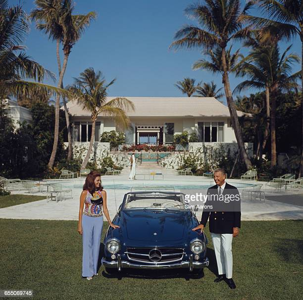 Alvin and Lilly Fuller with their Mercedes 190SL roadster outside their new home in Palm Beach Florida May 1970