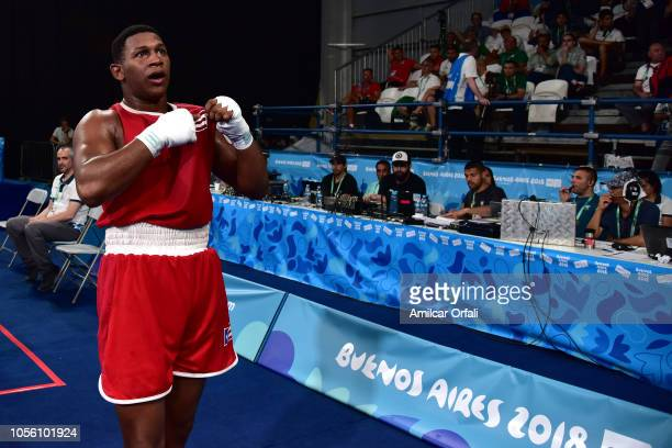 Alvin Canales of Puerto Rico celebrates his victory in Men's Heavy Bronze Medal Bout during day 11 of Buenos Aires 2018 youth Olympic Games at...